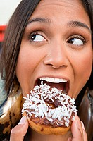 Woman eating a doughnut