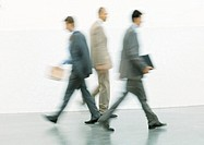 Businessmen walking, blurred motion