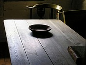 Still life with an old wooden bowl on a very old table. Bible on the right on the table