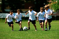 Group of five boys enjoying soccer