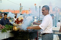 Jemaa El Fna place - Shopkeeper behind a barbecue