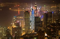 Hong Kong´s modern skyline overlooking Victoria harbour and Kowloon peninsula at night, Hong Kong, China