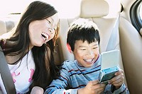 Brother and Sister Laughing in Car