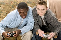 Teen boys playing video games.