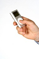 Close-up of a person's hand holding an MP3 Player