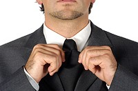 Close-up of a businessman adjusting his tie (thumbnail)