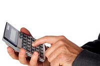 Close-up of a businessman using a calculator