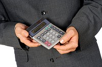 Mid section view of a businessman holding a calculator