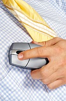 Mid section view of a businessman holding a computer mouse