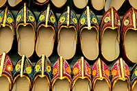 Close-up of shoes hanging at a store in a market, Pushkar, Rajasthan, India
