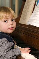 2 year Caucasian boy playing piano