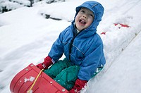 3 year old on snow sled