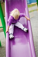 2.5 year old Caucasian girl on play ground slide