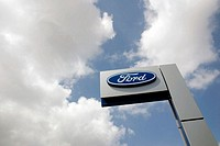 Logo of 'Ford' with cloudy sky