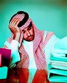 Desperate Arab businessman at his desk (thumbnail)