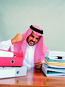 Arab businessman being angry at his desk