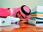 Arab businessman sleeping at his desk