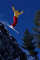 Man skiing off edge of cliff