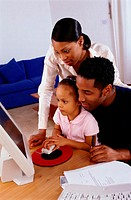 Parents and Daughter Using a Computer