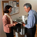 Businesspeople Using a Photocopier
