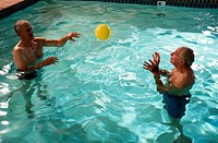 Men Playing Ball in the Water for Physical Therapy