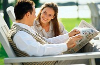Couple Reading a Newspaper Outside