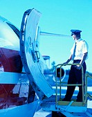 Pilot Beside Cargo Plane