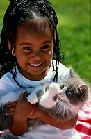 Young African American Girl with Kitten
