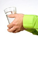Close-up of a man´s hands holding a glass of water