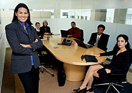 Group of executives meeting in conference room, portrait