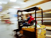 Man operating a forklift, blurred motion