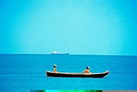 Two young men kayaking in the sea