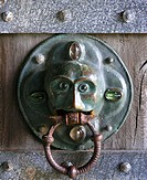 The doorhandle. Probably a christ representation. Hjerl Hede open air museum, near Sevel in western Jutland Denmark. A copy of Tjorring kirke as it or...