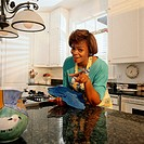Woman in a Suburban Kitchen