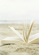 Open book laying in sand