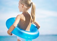 Little girl with innertube around waist
