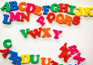 Magnetic colored letters on white board in classroom, Eugene, Oregon, USA