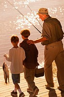 Grandfather & grandsons with fishing gear
