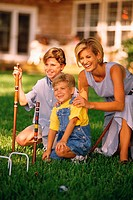 Mom and kids playing croquet