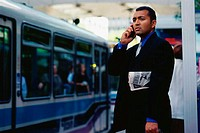 Businessman waiting for bus