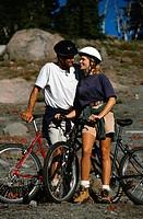 Man and Woman Mountain Biking
