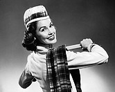 Woman wearing glengarry cap and tartan
