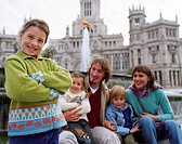 Spain, Madrid, girl (8-10) by family in Plaza de la Cibeles, portrait