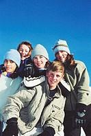 Five teenagers (13-15) smiling, portrait