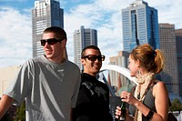 Melbourne, Australia, young woman and two young men, smiling, close-up