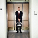Businessman in an Elevator