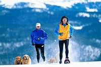 YOUNG WOMEN WITH GOLDEN RETRIEVERS IN COLORADO
