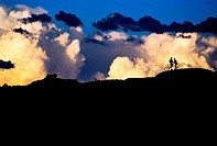 Mountain bikers in silhouette against sky,Capitol Reef,Utah,USA