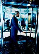 Man and Revolving Door