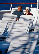 Couple Sitting in Cruise Ship Deck Chairs